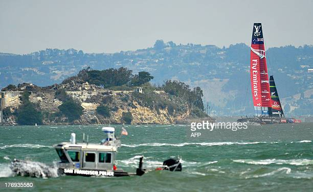 A San Francisco Police boat patrols the bay while Emirates Team New Zealand sails their AC72 during the third race of the Louis Vuitton Cup in San...