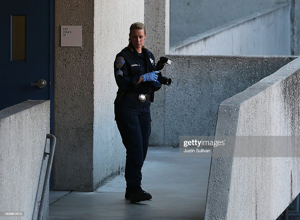 A San Francisco police officer inspects an outdoor stairwell at San Francisco General Hospital on October 8, 2013 in San Francisco, California. 57-year-old Lynne Spalding, of San Francisco was believed to have been found dead this morning in a remote stairwell at San Francisco General Hospital after she was reported missing from her hospital room more than two weeks ago. Spalding was last seen on September 21 by hospital employees after she was undergoing treatment for an infection.