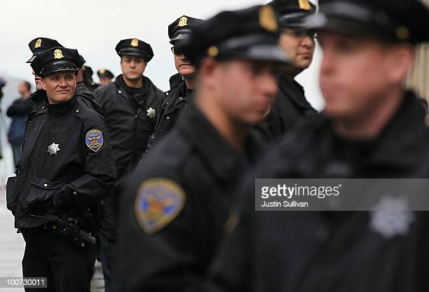 San Francisco police officers monitor a protest outside of the Fairmont Hotel before US President Barack Obama arrives for a fundraiser May 25 2010...