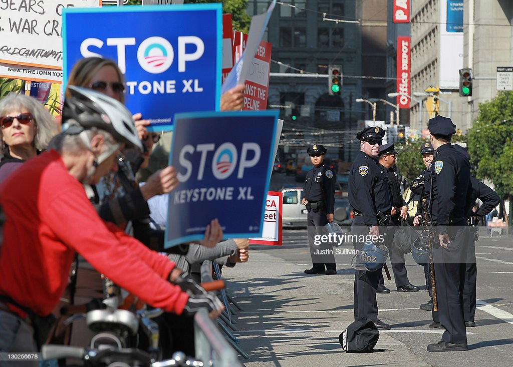 San Francisco police officers monitor protestors outside of the W Hotel before the arrival of U.S. President Barack Obama on October 25, 2011 in San Francisco, California. Hundreds of protestors from a wide variety of activist groups staged protests outside of the W Hotel where President Obama was holding a $7,500 per person fundraiser.