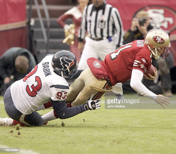 San Francisco quarterback Alex Smith is tackled by Houston linebacker Jason Babin during the 49ers 2017 overtime defeat of the Houston Texans January...