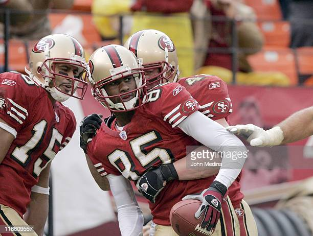 San Francisco receiver Brandon Lloyd is congratulated by teammates after catching a touchdown pass during the 49ers 2017 overtime defeat of the...
