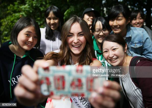 San Francisco rose Amanda Donohoe poses for a selfie with tourists as roses from Ireland and overseas who are preparing for their journey to Tralee...