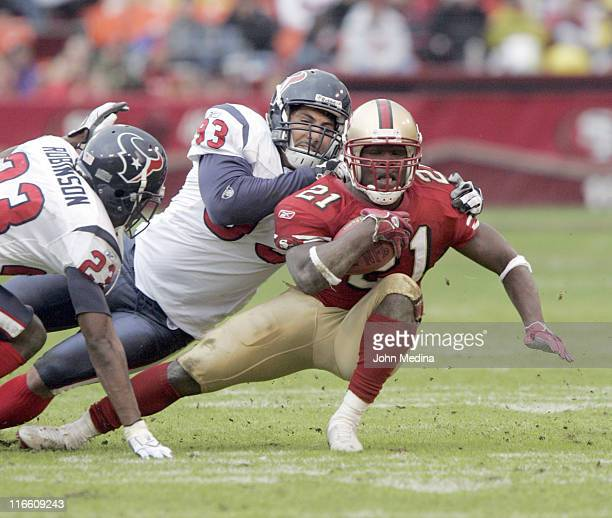 San Francisco running back Frank Gore is tackled by Houston linebacker Jason Babin during the 49ers 2017 overtime defeat of the Houston Texans...
