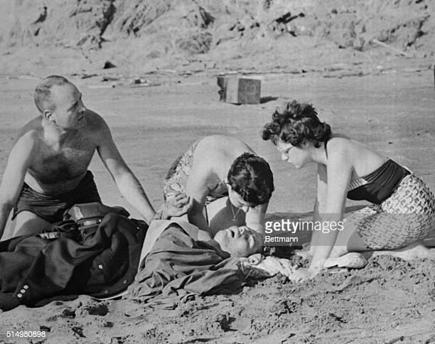 San Francisco State College student Albert Kolger lies mortally wounded on the beach here May 7 after being attacked by a great white shark as he and...
