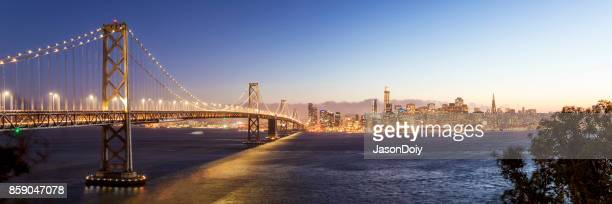 san francisco skyline and bay bridge - san francisco california stock photos and pictures