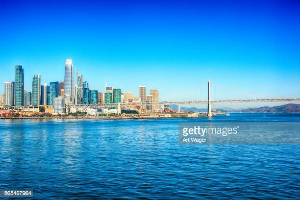 san francisco skyline and bay bridge - bay bridge stock pictures, royalty-free photos & images
