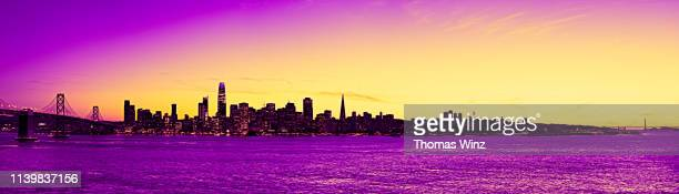 san francisco skyline at dusk and bay bridge - saturated colour stock pictures, royalty-free photos & images