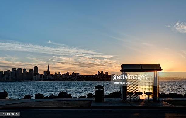 san francisco skyline with bus stop - treasure island california stock pictures, royalty-free photos & images