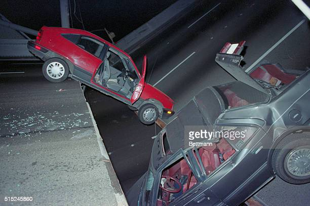 San Francisco; Two cars are trapped on the collapsed section of the Bay Bridge following earthquake.