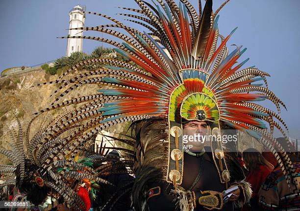 Aztec dancers participate in a sunrise Unthanksgiving Day ceremony with Native Americans 24 November 2005 on Alcatraz Island home to the ruins of the...