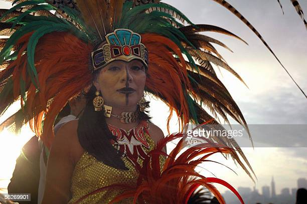 Lidia Doniz performs with the Teo Kali Aztec cultural group during an Unthanksgiving Day ceremony at sunrise with Native Americans 24 November 2005...