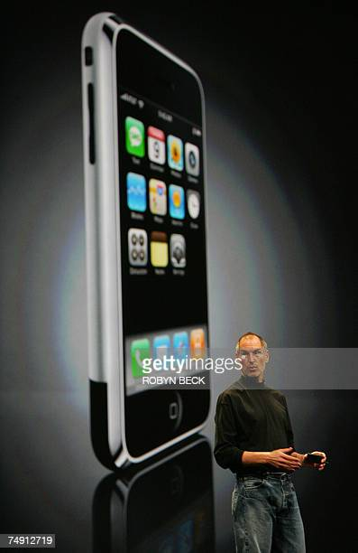 TO GO WITH STIRY by Glenn Chapman LifestyleUSITtelecomcompanyInternetAppleJobs In this 11 June 2007 file photo Apple Inc CEO Steve Jobs discusses the...