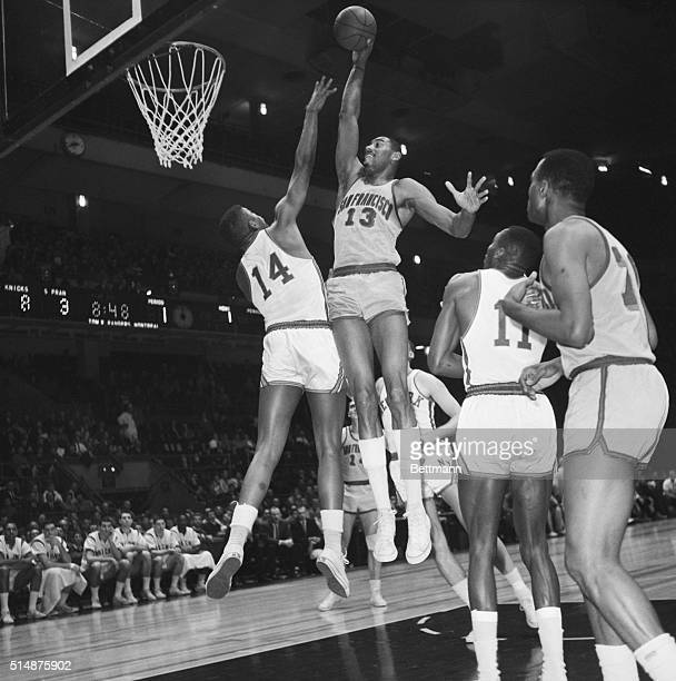San Francisco Warrior center Wilt Chamberlain shoots the ball over New York Knicks defender Paul Hogue in the first quarter of a National Basketball...