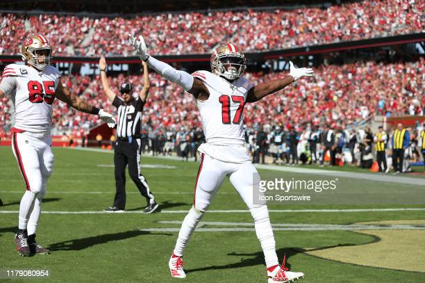 San Francisco wide receiver Emmanuel Sanders celebrates a touchdown in his first game as a 49er during an NFL football game against the Carolina...