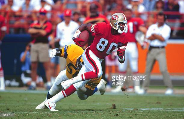 San Francisco WIDE RECEIVER JERRY RICE CARRIES THE BALL FOLLOWING A RECEPTION DURING THE 49ERS 3419 VICTORY OVER THE LOS ANGELES RAMS AT ANAHEIM...