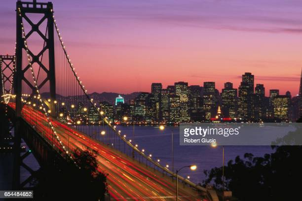 san francisco-oakland bay bridge at sunset - oakland california skyline stock pictures, royalty-free photos & images
