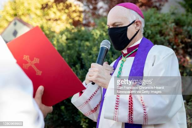 San Francisco's Archbishop Salvatore Joseph Cordileone conducts an exorcism outside of Church of Saint Raphael in San Rafael, Calif. Saturday,...