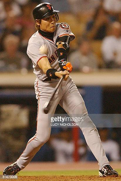 San Fransisco Giants' Japanese player Tsuyoshi Shinjo hits a foul ball in the top of the eighth inning in Los Angeles CA 19 September 2002 AFP...