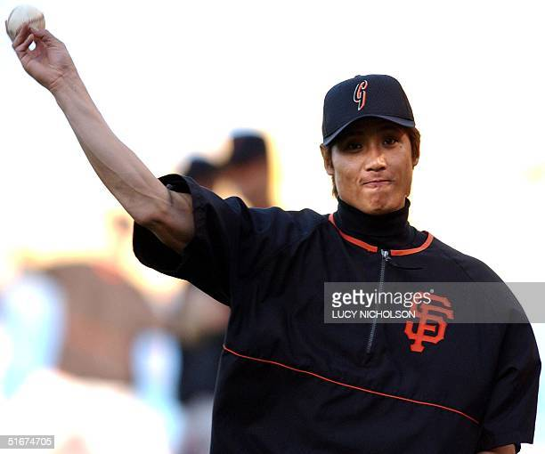 San Fransisco Giants' Japanese player Tsuyoshi Shinjo warms up before the game against the Los Angeles Dodgers in Los Angeles CA 16 September 2002...