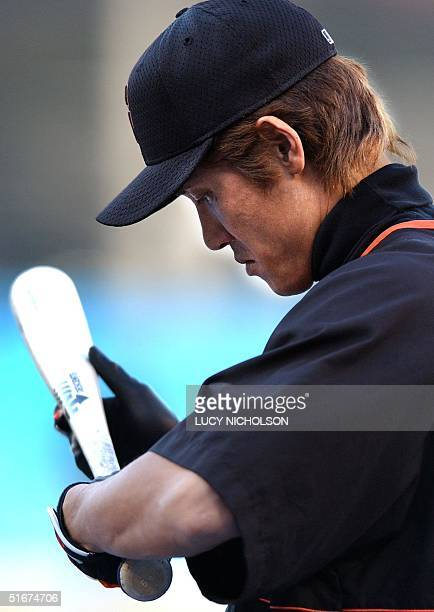 San Fransisco Giants' Tsuyoshi Shinjo warms up before the game against the Los Angeles Dodgers in Los Angeles CA 16 September 2002 AFP PHOTO/Lucy...