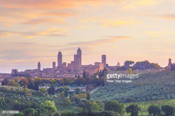 san gimignano in tuscany, italy at dusk - siena italy stock photos and pictures