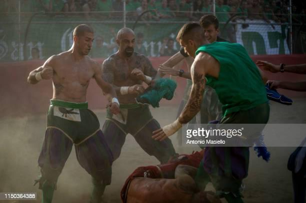 San Giovanni Verdi Team and Santa Maria Novella Rossi Team fight during the semifinal match of the Calcio Storico Fiorentino at Piazza Santa Croce on...