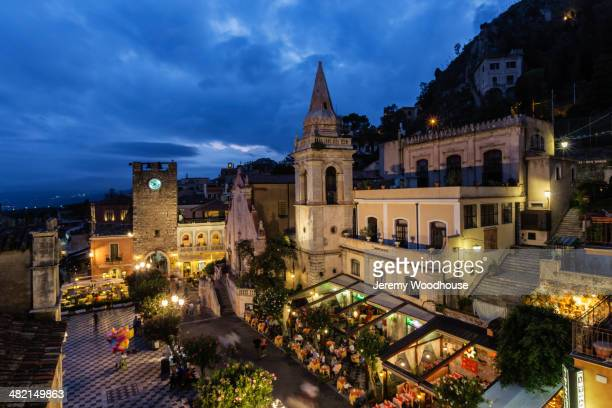 san giuseppe church and piazza illuminated at night, taormina, sicily, italy - taormina stock pictures, royalty-free photos & images