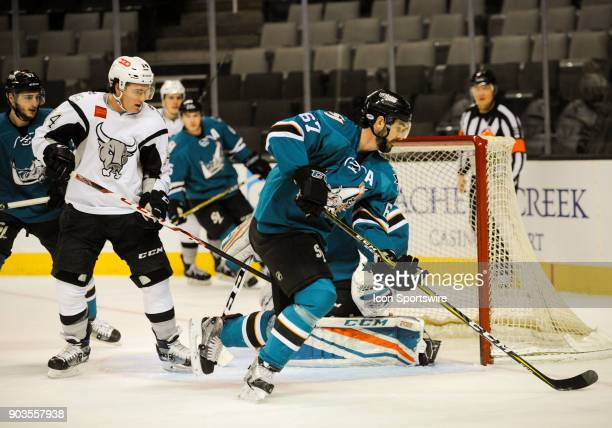 San Jose Barracuda defenseman Jacob Middleton skates with the puck to draw the defending player away from the net during the regular season game...