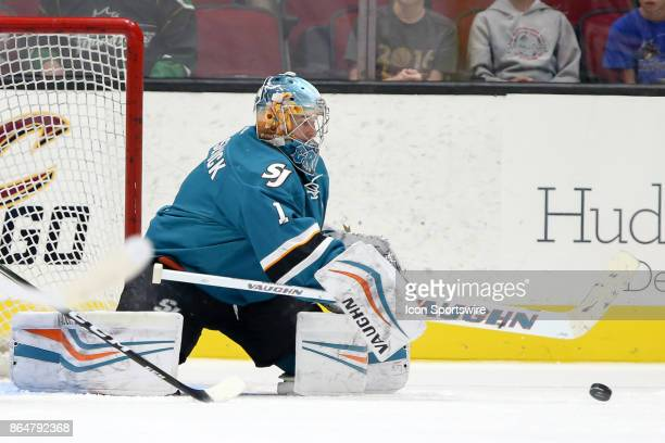San Jose Barracuda goalie Troy Grosenick reaches for the puck during the first period of the AHL hockey game between the San Jose Barracuda and...