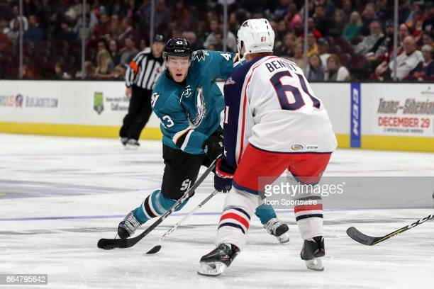 San Jose Barracuda right wing Filip Sandberg shoots as Cleveland Monsters defenseman Andre Benoit defends during the third period of the AHL hockey...