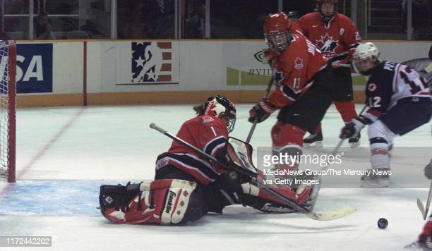 Canadian Olympic Women's ice hockey goalie Sami Jo Small who attended Stanford makes a save in the first period