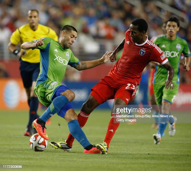 San Jose Earthquakes' Atiba Harris fights for the ball during the second half of their game against the Seattle Sounders FC Clint Dempsey at the new...
