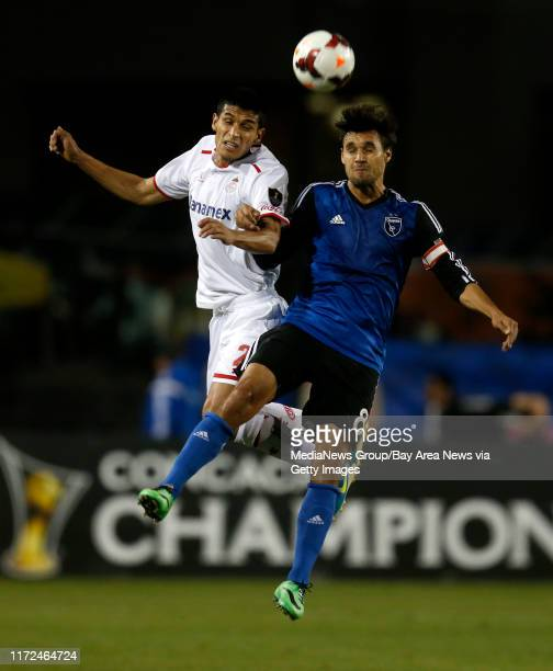 San Jose Earthquakes' Chris Wondolowski fights for the ball against Deportivo Toluca FC's Francisco Gamboa in the first half at Buck Shaw Stadium in...