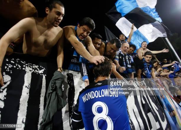 San Jose Earthquakes' fans celebrate with San Jose Earthquakes' Chris Wondolowski following their 11 tie against Deportivo Toluca FC at Buck Shaw...
