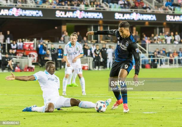 San Jose Earthquakes forward Danny Hoesen scoots the ball past Seattle defender Nouhou Tolo during a Round of 16 US Open Cup match between the...
