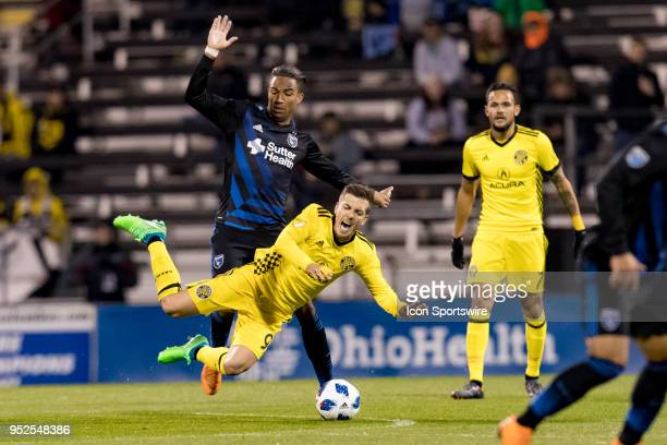 San Jose Earthquakes forward Danny Hoesen trips Columbus Crew midfielder Pedro Santos in the MLS regular season game between the Columbus Crew SC and...