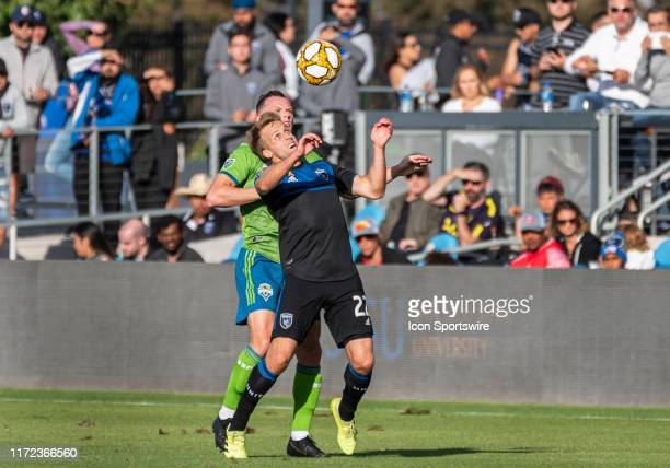 San Jose Earthquakes forward Tommy Thompson gets ready to pull down the ball in front of Seattle Sounders defender Brad Smith during the match...