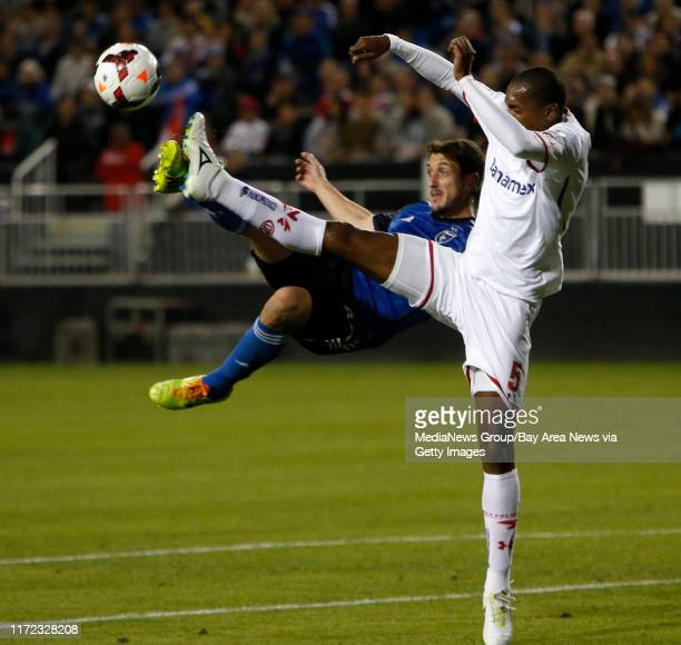 San Jose Earthquakes' JeanBaptiste Pierazzi fights for the ball against Deportivo Toluca FC's Wilson Tiago in the second half at Buck Shaw Stadium in...