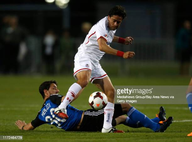 San Jose Earthquakes' JeanBaptiste Pierazzi fights for the ball against Deportivo Toluca FC's Gabriel Velasco in the first half at Buck Shaw Stadium...
