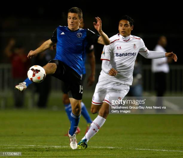 San Jose Earthquakes' JJ Koval controls the ball against Deportivo Toluca FC's Ra√∫l Nava in the second half at Buck Shaw Stadium in Santa Clara...