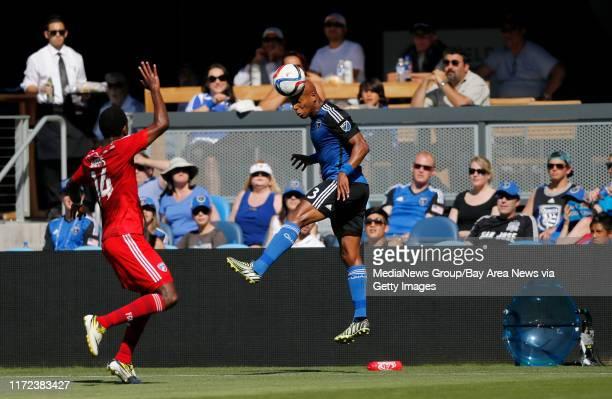 San Jose Earthquakes' Jordan Stewart hits a header against FC Dallas' Atiba Harris in the first half at Avaya Stadium in San Jose Calif on Thursday...