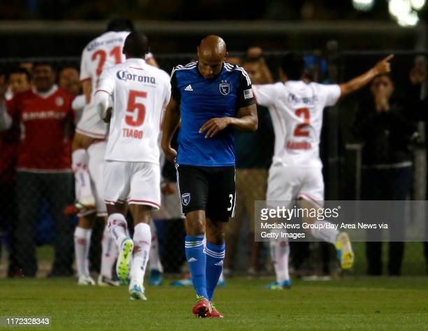 San Jose Earthquakes' Jordan Stewart walks back to midfield after Deportivo Toluca FC scored the first goal of the game in the second half at Buck...