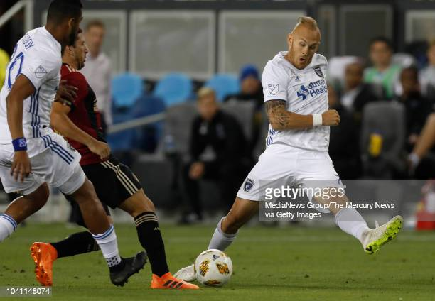 San Jose Earthquakes' Magnus Eriksson fights for the ball against Atlanta United's Eric Remedi in the first half at Avaya Stadium in San Jose Calif...