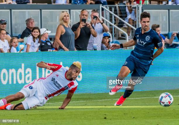 San Jose Earthquakes midfielder Anibal Godoy slips of the turf with Sporting Kansas City midfielder Benny Feilhaber in pursuit during the regular...