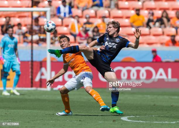 San Jose Earthquakes midfielder Florian Jungwirth stretches to keep the ball away from Houston Dynamo forward Erick Torres during the MLS match...