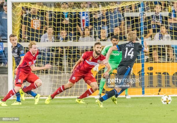 San Jose Earthquakes midfielder Jackson Yueill positioning himself in front of the goal while Chicago Fire defender Jonathan Campbell and Chicago...