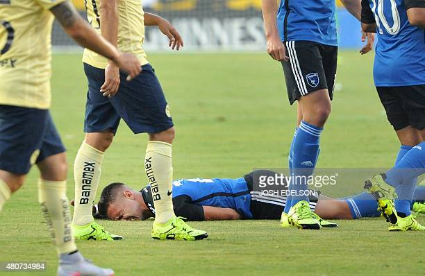 San Jose Earthquakes midfielder Leandro Barrera reels in pain after taking a hit during an International Champions Cup football match against Club...
