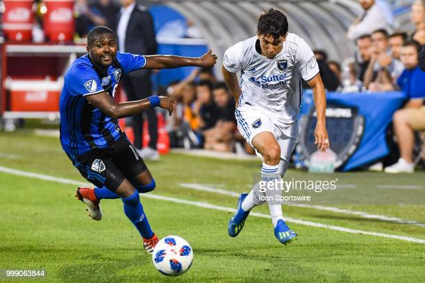 San Jose Earthquakes midfielder Shea Salinas kicks the ball before Montreal Impact midfielder Raheem Edwards reaches him during the San Jose...