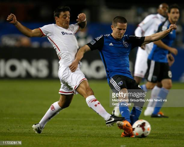 San Jose Earthquakes' Sam Cronin fights for the ball against Deportivo Toluca FC's Carlos Esquivel in the first half at Buck Shaw Stadium in Santa...